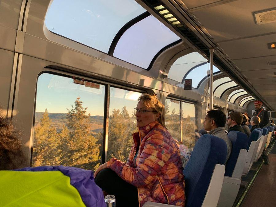 Passengers on Amtrak's Winter Park Ski Train soak in a sunrise in March 2019. (Jesse Paul, The Colorado Sun)