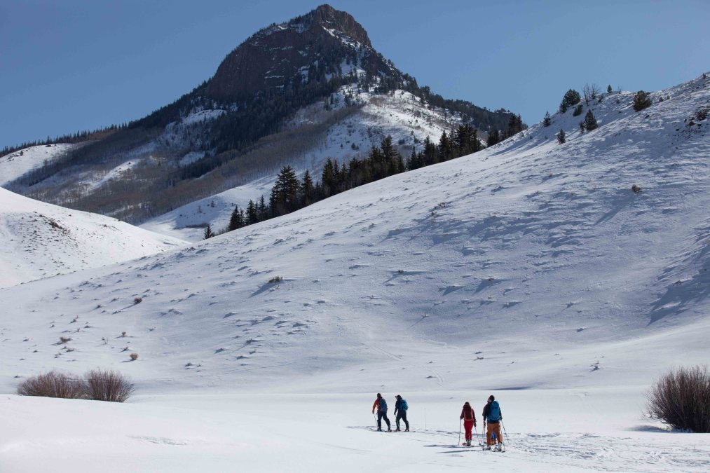 Skiers begin their day at Bluebird Backcountry in mid-March. The state's first-ever human-powered, backcountry ski area drew hundreds of skiers to slopes spilling from the prominent Whiteley Peak outside Kremmling. (Shondia Houtzer, Special to The Colorado Sun)