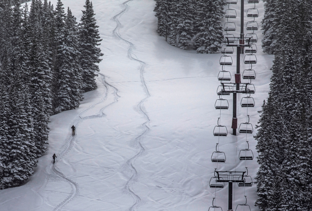 A pair of skiers skin uphill at Loveland Ski Area on March, 20, 2020, near Georgetown. With many closures in Colorado due to the coronavirus pandemic, many more skiers and snowboarders opt for uphilling equipment to keep skiing in the backcountry and on ski resorts without chairlifts running. (Hugh Carey, Special to The Colorado Sun)