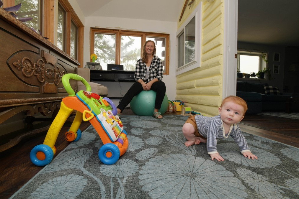 Tegan Ebbert is shown Aug. 7, 2021, with her six-month-old son August, at her home office near Hayden. (Matt Stensland, Special to The Colorado Sun)